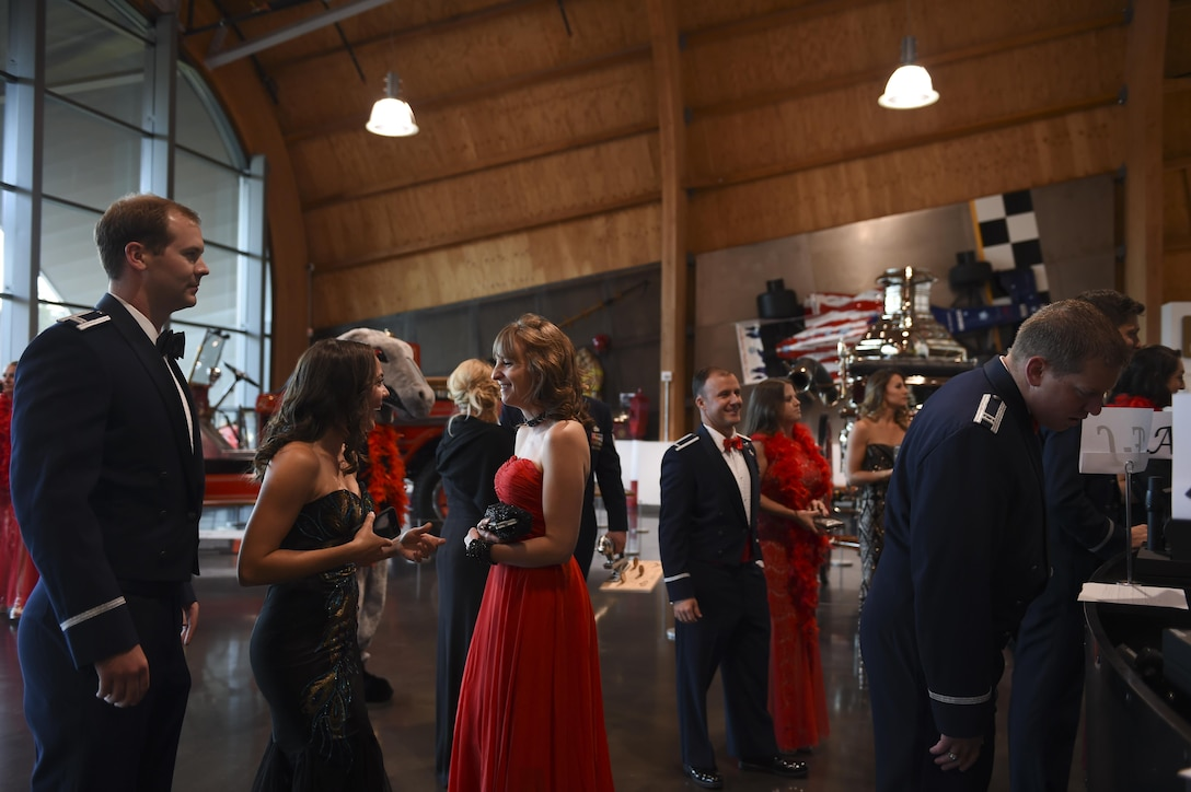 Guests of the McChord Air Force Ball check in at the Lemay America's Car Museum in Tacoma, Wash., Sept. 23, 2016. Approximately 500 Airmen, Soldiers, civilians, Reservists, Guardsmen and their guests attended the event, which celebrated the 69th birthday of the United States Air Force. (U.S. Air Force photo/Staff Sgt. Naomi Shipley)