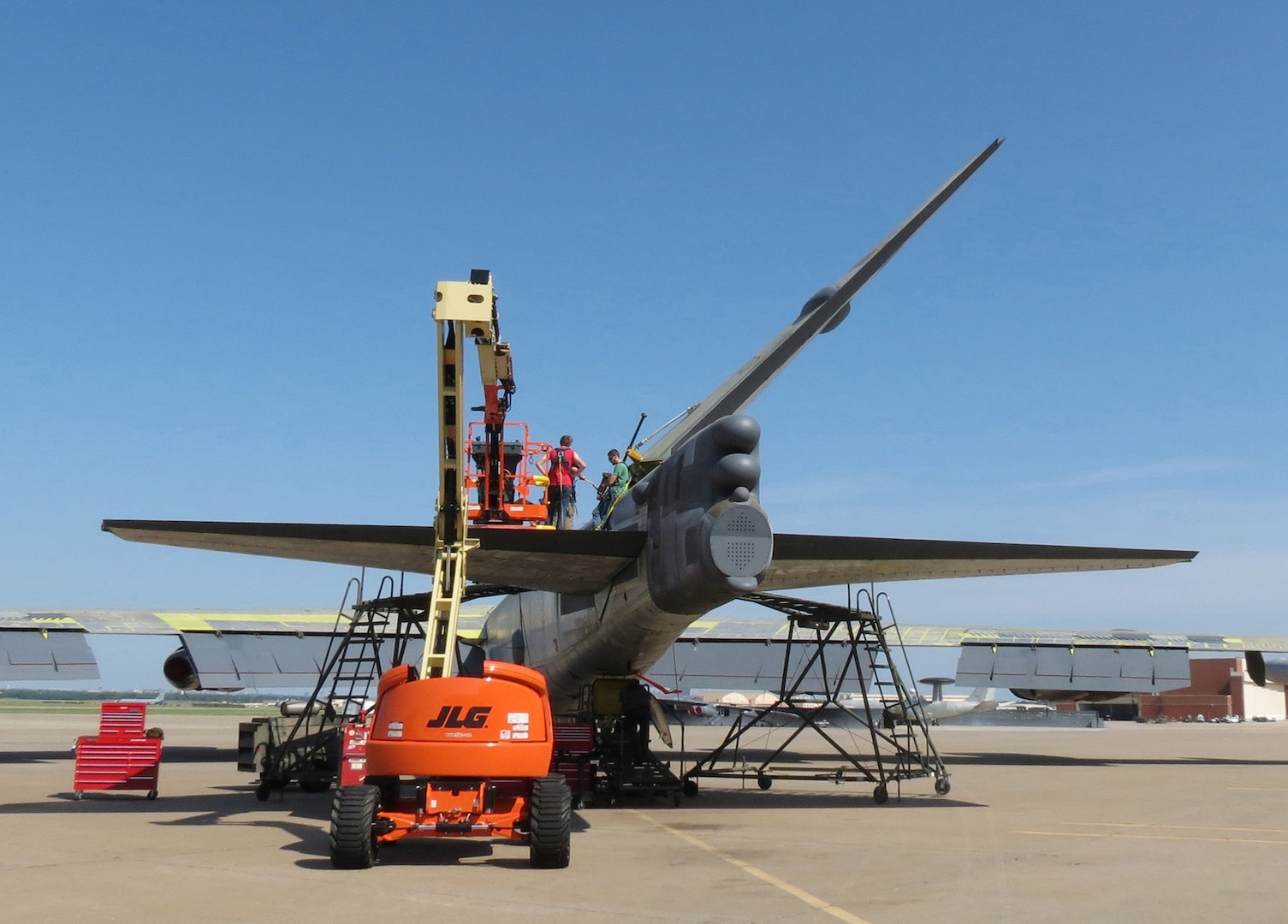 """Members of the 565th Aircraft Maintenance Squadron reattach the tail on """"Ghost Rider"""" July 31, 2016. The B-52H Stratofortress, tail number 61-007, recently underwent extensive programmed depot maintenance at Tinker Air Force Base. 'Ghost Rider' is the first B-52H to ever be regenerated from long-term storage with the 309th Aerospace Maintenance and Regeneration Group at Davis-Monthan AFB, Ariz., and returned to fully-operational flying status. (Air Force photo)"""
