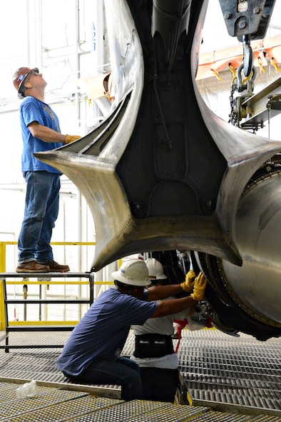 """Members of the 565th Aircraft Maintenance Squadron install one of eight engines on """"Ghost Rider"""" July 8, 2016. The B-52H Stratofortress, tail number 61-007, recently underwent extensive programmed depot maintenance at Tinker Air Force Base. 'Ghost Rider' is the first B-52H to ever be regenerated from long-term storage with the 309th Aerospace Maintenance and Regeneration Group at Davis-Monthan AFB, Ariz., and returned to fully-operational flying status. (Air Force photo by Kelly White)"""