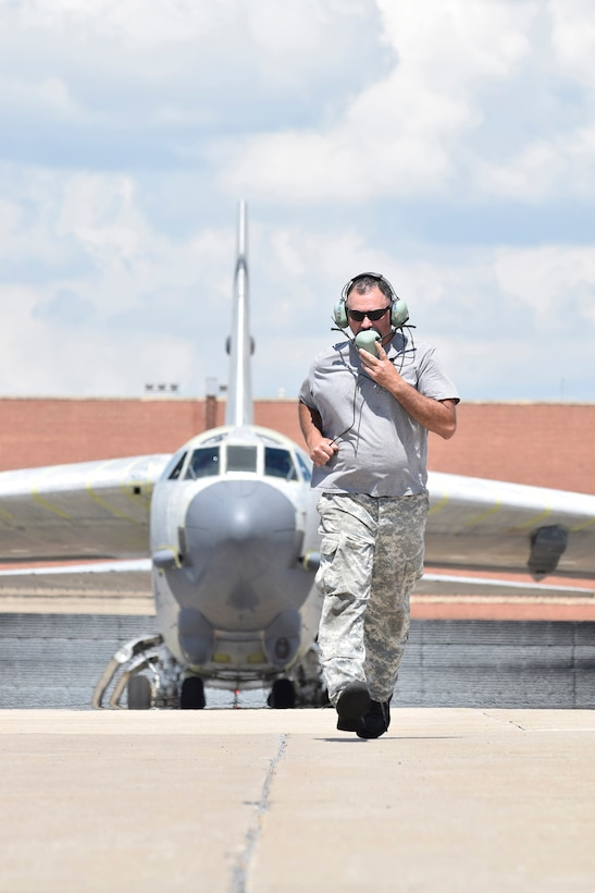 Mark Smith, 565th Aircraft Maintenance Squadron B-52H crew chief runs to position himself in front of B-52H 61-0007, 'Ghost Rider,' in order to launch the aircraft on an attempted functional test flight at the Oklahoma City Air Logistics Complex, Aug. 29, 2016, Tinker Air Force Base, Okla. 'Ghost Rider' is the first B-52H to ever be regenerated from long-term storage with the 309th Aerospace Maintenance and Regeneration Group at Davis-Monthan AFB, Ariz., and returned to fully-operational flying status. (U.S. Air Force photo/Greg L. Davis)