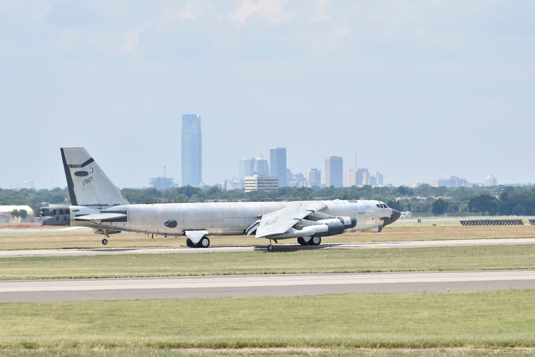 B-52H, 61-0007, 'Ghost Rider,' taxis with the skyline of Oklahoma City visible in the background before an attempted functional test flight after undergoing a 19-month overhaul and upgrade by the Oklahoma City Air Logistics Complex, Aug. 29, 2016, Tinker Air Force Base, Okla. 'Ghost Rider' is shown in natural metal since it has been overhauled and must be checked for full functionality before being painted. 61-0007 is the first B-52H to ever be regenerated from long-term storage with the 309th Aerospace Maintenance and Regeneration Group at Davis-Monthan AFB, Ariz., and returned to fully-operational flying status. (U.S. Air Force photo/Greg L. Davis)