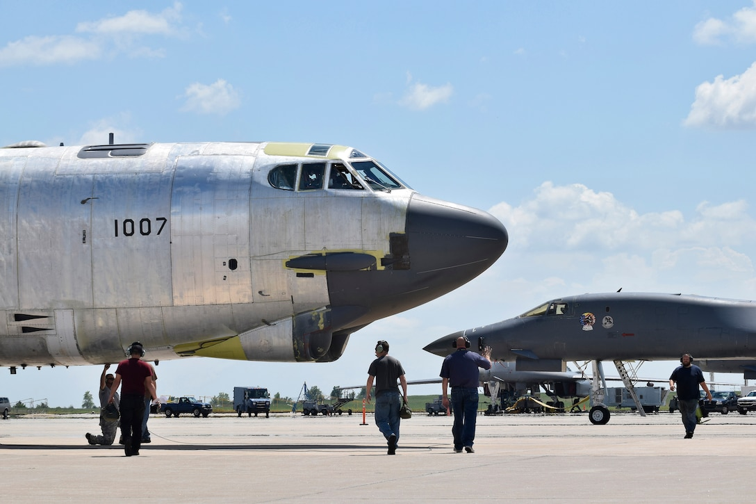 Maintenance personnel from the 565th Aircraft Maintenance Squadron work under and around B-52H 61-0007, 'Ghost Rider,' as the aircraft undergoes checks for an attempted functional test flight at the Oklahoma City Air Logistics Complex, Aug. 29, 2016, Tinker Air Force Base, Okla. 'Ghost Rider' is shown in natural metal as it completes a 19-month overhaul and upgrade to become the first B-52H to ever be regenerated from long-term storage with the 309th Aerospace Maintenance and Regeneration Group at Davis-Monthan AFB, Ariz., and returned to fully-operational flying status. (U.S. Air Force photo/Greg L. Davis)