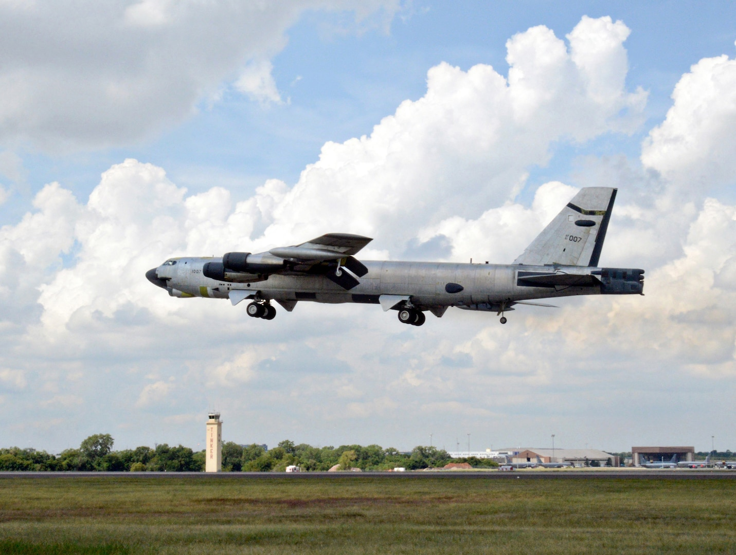 """""""Ghost Rider,"""" takes to the skies for a functional test flight Aug. 30, 2016, at Tinker Air Force Base, Okla. The B-52H Stratofortress is shown in natural metal since it has been overhauled and must be checked for full functionality before being painted. 61-0007 is the first B-52H to ever be regenerated from long-term storage with the 309th Aerospace Maintenance and Regeneration Group at Davis-Monthan AFB, Ariz., and returned to fully-operational flying status. (U.S. Air Force photo by Kelly White)"""