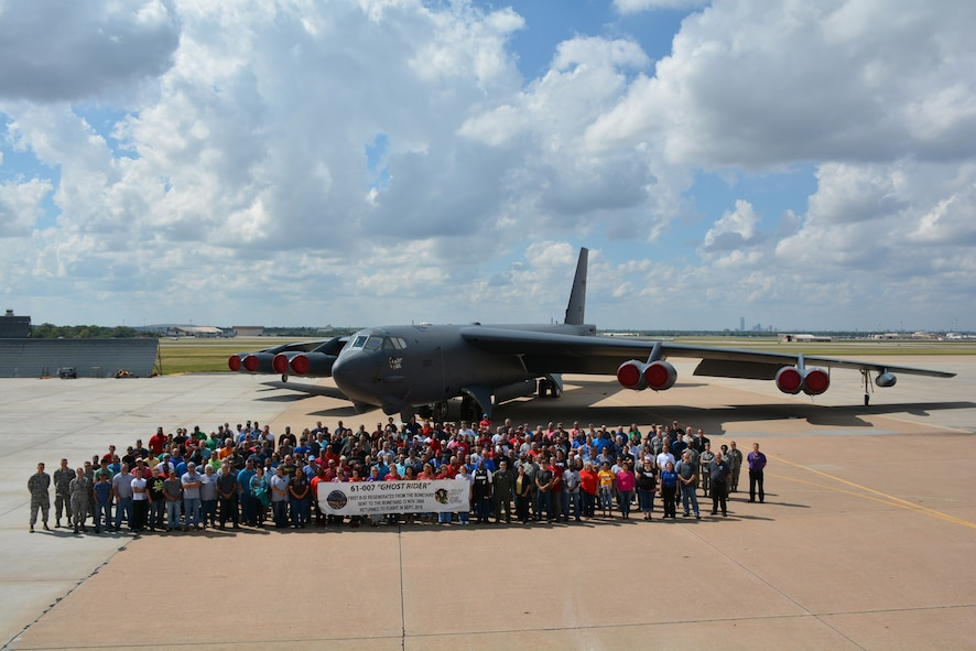 The Ghost Rider Enterprise Team pose Sept. 23, 2016, in front of the historic B-52H Stratofortress that was taken from the National Level Reservoir of Air and Space Capability, the world's largest airplane storage facility, run by the 309th Aerospace Maintenance and Regeneration Group near Tucson, Ariz. Ghost Rider spent the last 9 months undergoing extensive programmed depot maintenance at the Oklahoma City Air Logistics Complex before going back into the fight. The team is made up of members of the OC-ALC, 76th Aircraft Maintenance Group, 76th Propulsion Maintenance Group, 76th Commodities Maintenance Group, 848th Supply Chain Management Group, Air Force Life Cycle Management Center, 10th Flight Test Squadron and Defense Logistics Agency. (Air Force photo by Darren D. Heusel)