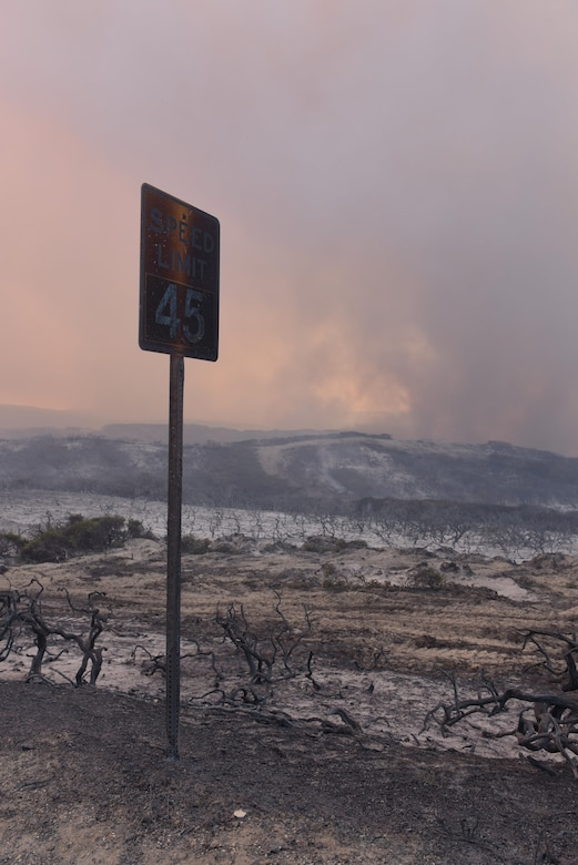 A speed limit sign on South Vandenberg is shown burned after a significant fire swept through portions of South Base, Sept. 20, 2016, Vandenberg Air Force Base, Calif. Vandenberg personnel, alongside community partners and a specialized incident management team, have worked to extinguish five separate wildland fires, here, since Sept. 17. (U.S. Air Force photo by Staff Staff Sgt. Shane Phipps/Released)