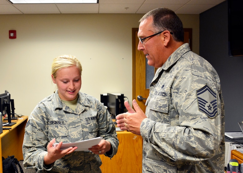 Military Personnel Section Customer Support Technician Senior Airman Brittany Basinger provides customer service to Senior Master Sgt. Theodore Clark during the regularly scheduled drill at the 120th Airlift Wing in Great Falls, Mont. Sept. 13, 2016. (U.S. Air National Guard photo by Senior Master Sgt. Eric Peterson)