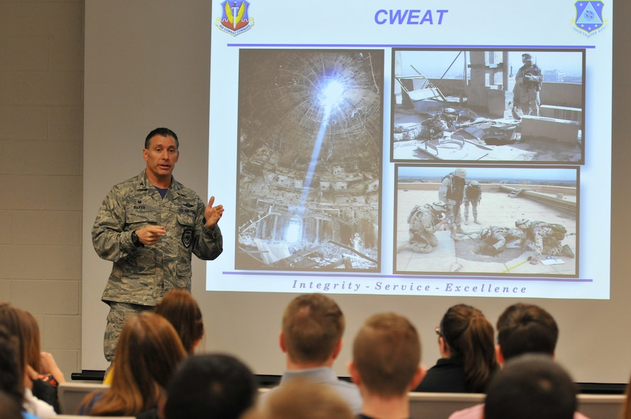 Col. Craig Baker, 180th Fighter Wing Commander, discusses effective leadership with students from University of Toledo's College of Business and Innovation, March 18, 2016. The college's honors students visited the wing to learn about military leadership and how it applies to mission success. Air National Guard photo by Staff Sgt. Shane Hughes.