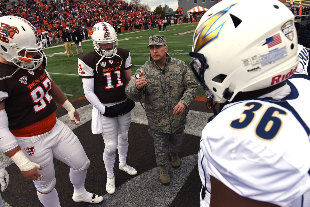 U.S. Air Force Col. Craig Baker, commander of the 180th Fighter Wing in Swanton, Ohio, performs the coin toss to start the Bowling Green State University Falcons Military Appreciation football game against the Akron Zips in Bowling Green, Ohio on Oct. 17, 2015. The Military Appreciation event, which was also the university's homecoming game, was free for military members, highlighted veterans and their families on the field, and strengthened the community ties the 180th Fighter Wing strives to create. (Air National Guard photo by Tech. Sgt. Nic Kuetemeyer/released)