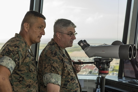 U.S. Marine Corps Sgt. Maj. Mario A. Marquez, left, 1st Marine Aircraft Wing (MAW) sergeant major, and U.S. Marine Corps Sgt. Maj. Lee D. Bonar Jr., III Marine Expeditionary Force (MEF) sergeant major, observe Marine Corps Air Station Iwakuni during a command visit at MCAS Iwakuni, Japan, Sept. 27, 2016. The command visit entailed a meeting with the senior enlisted leaders of the air station, staff noncommissioned officer professional military education, breakfast with noncommissioned officers and afforded the senior enlisted leaders of III MEF, Marine Corps Installations Pacific and 1st MAW the opportunity to view the transformation of the air station. (U.S. Marine Corps photo by Lance Cpl. Aaron Henson)