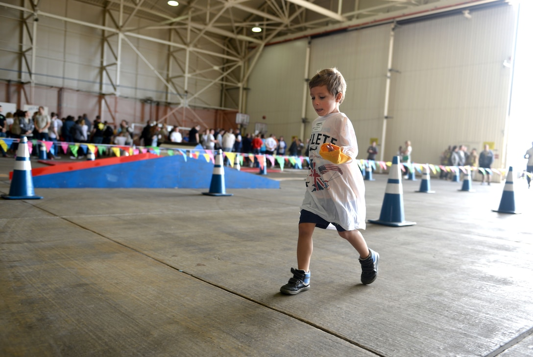 A child athlete participates in the 100-yard race during the 35th Annual Joan Mann Special Sports Day Sept. 24, 2016, on RAF Mildenhall, England. More than 500 volunteers, Airmen and dependents from RAF Mildenhall, RAF Lakenheath and RAF Feltwell made this event possible for more than 200 athletes. (U.S. Air Force photo by Staff Sgt. Kate Thornton)