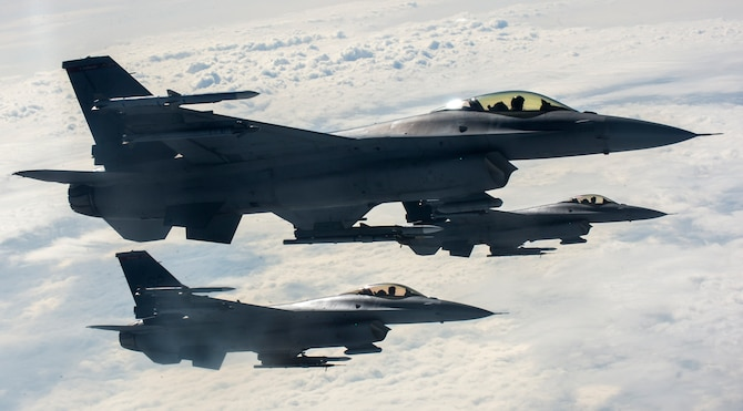 U.S. Air Force F-16 Fighting Falcons fly beside a KC-135 Stratotanker from the 191st Air Refueling Squadron, Roland R. Wright Air National Guard Base, Utah, after receiving fuel during a refueling mission over Ramstein Air Base, Germany, Sept. 26, 2016. The Stratotanker helps Spangdahlem's F-16s train in air-to-air refueling for a longer duration and with more aircraft. (U.S. Air Force photo/Airman 1st Class Preston Cherry)