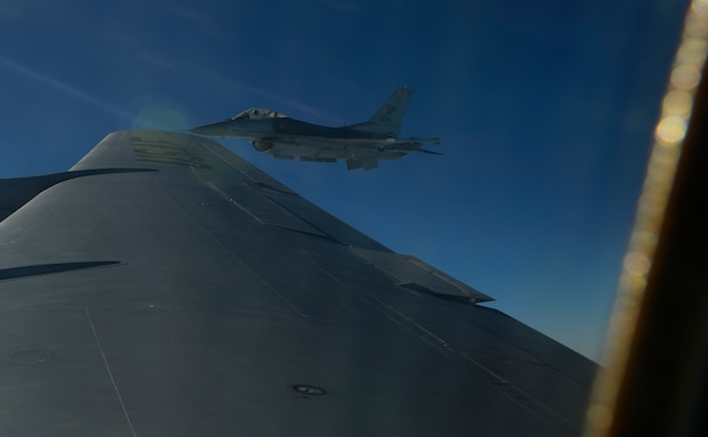 A U.S. Air Force F-16 Fighting Falcon assigned to the 52nd Fighter Wing flies past a KC-135 Stratotanker, assigned to the 191st Air Refueling Squadron, Roland R. Wright Air National Guard Base, Utah, over Ramstein Air Base, Sept. 27, 2016. The 191st ARS ANG unit conducted in-flight refueling exercise to demonstrate how tanker support can extend and prolong flight operations for U.S. and coalition aircraft. (U.S. Air Force photo/Senior Airman Dawn M. Weber)