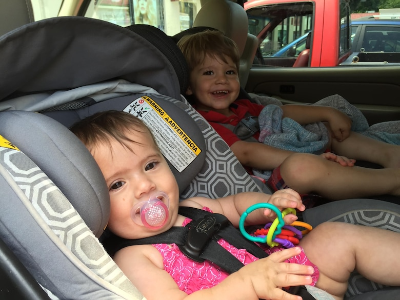 Two young children, ages nine months and 30 months, sit comfortably rear-facing in their car seats. The American Association of Pediatrics recommends children remain rear-facing for a minimum of two years. (U.S. Air Force photo/ W.C. Pope)