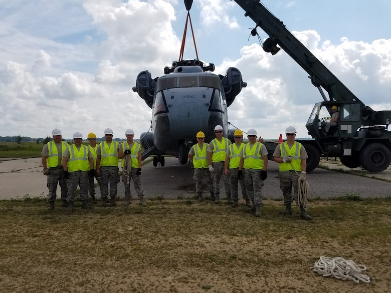CDDAR team members from the 934th Airlift Wing and 133rd Minnesota Air National Guard pose near the Sikorsky MH 53 they were required to move during the exercise.
