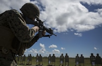 A Marine fires at his target during a table three range at Marine Corps Base Camp Lejeune, N.C., Sept. 21, 2016. Marines with 2nd Maintenance Battalion conducted a table 3-6 range to improve their short range accuracy, the speed at which they can acquire a target, as well as their ability to fire upon a target at an unknown distance.