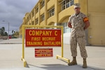Marine Corps Lance Cpl. Stephen J. Bayer, Charlie Company, 1st Recruit Training Battalion, stands outside his squad bay at Marine Corps Recruit Depot San Diego, Sept. 12, 2016. Marine Corps photo by Cpl. Angelica Annastas