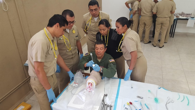 Col Antonio Delgado (pictured center), current Interim Director of AFMS International Health Specialist program, at an intubation station at CASEVAC training for Mexican Navy Medical Residents in Mexico City, Mexico. July 2016.