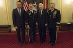 After receiving the Soldiers Medal, Lt. Col. David Diamond, second from left, poses with Secretary of the Army Eric Fanning, far left, Senator John McCain and Chief of Staff of the Army Gen. Mark Milley, far right. Photo by John Martinez, Senior Leadership of the Army