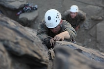 A Marine with 3rd Battalion, 8th Marine Regiments, climbs a rock face while attending Assault Climbers Course 3-16 at the Marine Corps Mountain Warfare Training Center, Sept 8, 2016.  The Assault Climber Course trains service members who work in ground combat arms military occupational specialties in mountain warfare tactics, techniques and procedures to serve effectively as force multipliers to their units during combat operations in complex, compartmentalized, and mountainous terrain.