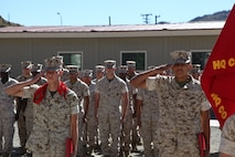 Cpl. Dakota Abrams and Lance Cpl. Javier Verdin Jr, salute for the first time after being meritoriously promoted aboard the Marine Corps Mountain Warfare Training Center, Sept 2, 2016.
