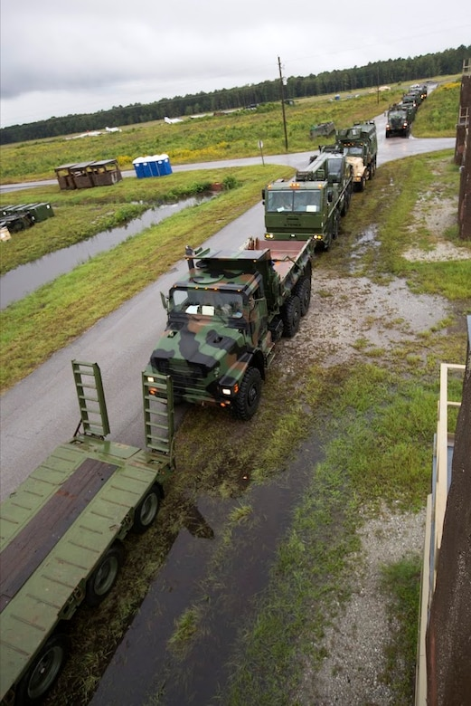 Vehicles are prepared for a convoy during a field exercise aboard Marine Corps Outlying Field Camp Davis, N.C., Sept. 22, 2016. Support squadrons across the Marine Corps conduct these exercises to remain ready for any challenge they may face in forward deployed environments. This exercise featured training that included auxiliary airfield construction, ground security and airfield damage repair. The squadron's capabilities contribute to 2nd Marine Aircraft Wing's role in the Marine Air Ground Task Force's mission accomplishment. Marines participating in the exercise are assigned to Marine Wing Support Squadron 274, Marine Aircraft Group 29, 2nd MAW. (U.S. Marine Corps photo by Sgt. N.W. Huertas/Released)