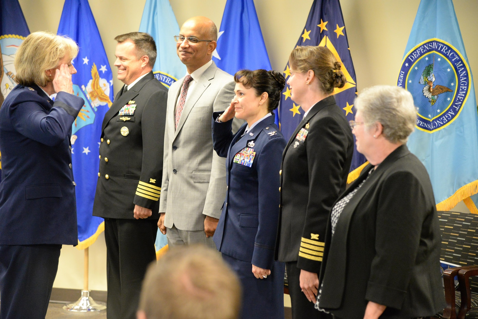 Air Force Lt. Gen. Wendy Masiello, Defense Contract Management Agency director, salutes the agency's regional commanders signaling the start of their new roles as operational unit leaders for their regions. The group assembled for a Sept. 22 ceremony at Fort Lee, Virginia, to mark the disestablishment of the agency's Operations Directorate.