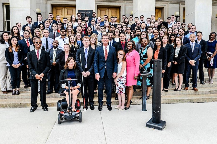 Defense Secretary Ash Carter takes a photograph with summer interns including those participating in the Workforce Recruitment Program at the Pentagon.
