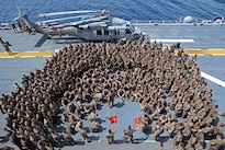 Navy Lt. Col. Brian Greene addresses a formation of Marines on the flight deck of the amphibious assault ship USS Bonhomme Richard in the Philippine Sea, Sept. 27, 2016. The Marines are assigned to 2nd Battalion, 4th Marine Regiment, 31st Marine Expeditionary Unit. The ship is supporting security and stability in the Indo-Asia-Pacific region. Navy photo by Petty Officer 2nd Class Sarah Villegas