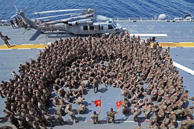 Navy Lt. Col. Brian Greene addresses a formation of Marines on the flight deck of the amphibious assault ship USS Bonhomme Richard in the Philippine Sea, Sept. 27, 2016. The ship is supporting security and stability in the Indo-Asia-Pacific region. Navy photo by Petty Officer 2nd Class Sarah Villegas