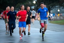 Crown Prince Frederik of Denmark, front left, leads a run with retired Air Force Tech. Sgt. Adam Popp at the National Mall in Washington, Sept. 28, 2016. Frederik and wounded veterans from Denmark and the United States ran 3.8 miles around the National Mall. DoD photo by EJ Hersom