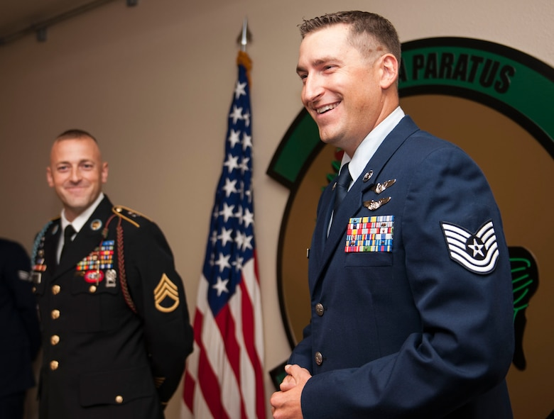 U.S. Air Force Tech. Sgt. Michael Elsik, laughs as he speaks at his and his brother's joint promotion Sept. 9, 2016, at Cannon Air Force Base, N.M. Elsik and his brother, U.S. Army Staff Sgt. Flint Elsik were promoted to the grade of E-6 together. (U.S. Air Force photo by Staff Sgt. Eboni Reams/Released)