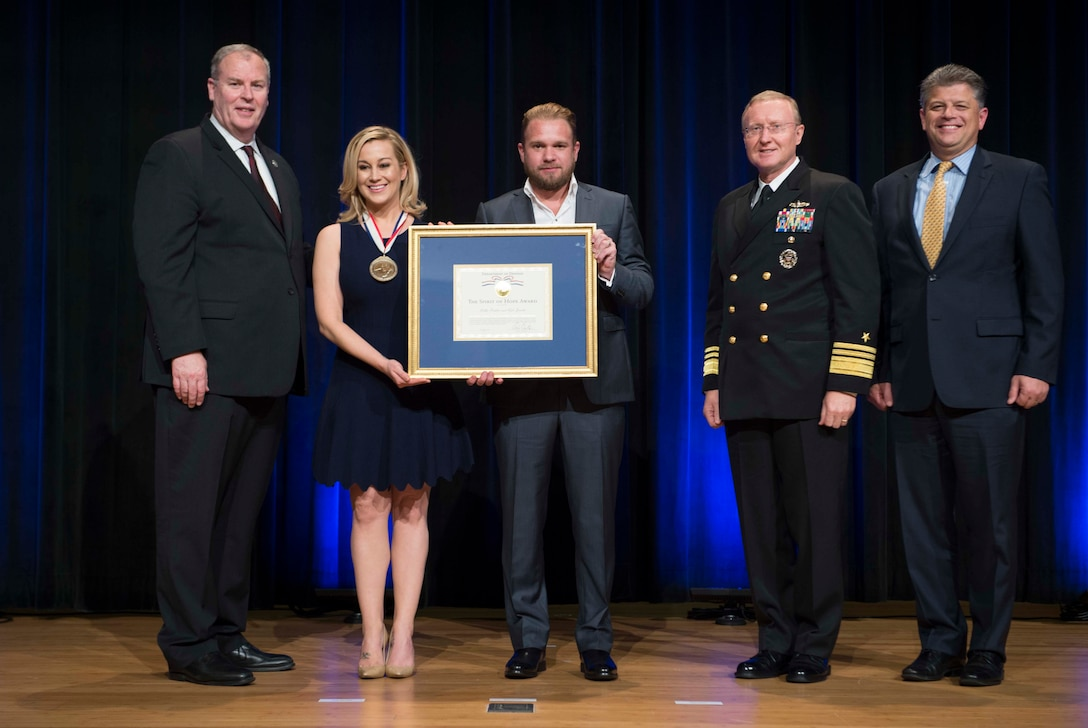 Deputy Defense Secretary  Bob Work presents the Spirit of Hope Award to singer Kellie Pickler and her songwriter-musician husband, Kyle Jacobs, at the Pentagon,Sept. 28, 2016. They were among the six individuals and one organization honored for their dedication to supporting the troops, in the spirit of the award's namesake, legendary entertainer Bob Hope. DoD photo by Navy Petty Officer 1st Class Tim D. Godbee