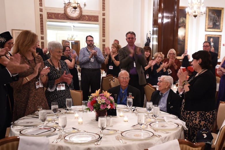 Guests attending the 70th anniversary of Easy Company, 2nd Battalion, 506th Parachute Infantry Regiment, 101st Airborne Division reunion applaud for World War II veterans Brad Freeman, sitting left, and Albert Mampre. Both men were members of Easy Company and the only two members at the reunion in Chicago, September 24, 2016.