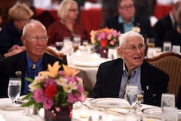 World War II veterans Brad Freeman, sitting left, and Albert Mampre listen to speakers during the 70th anniversary of Easy Company, 2nd Battalion, 506th Parachute Infantry Regiment, 101st Airborne Division reunion in Chicago, September 24, 2016. Both men were members of Easy Company and the only two members at the reunion.