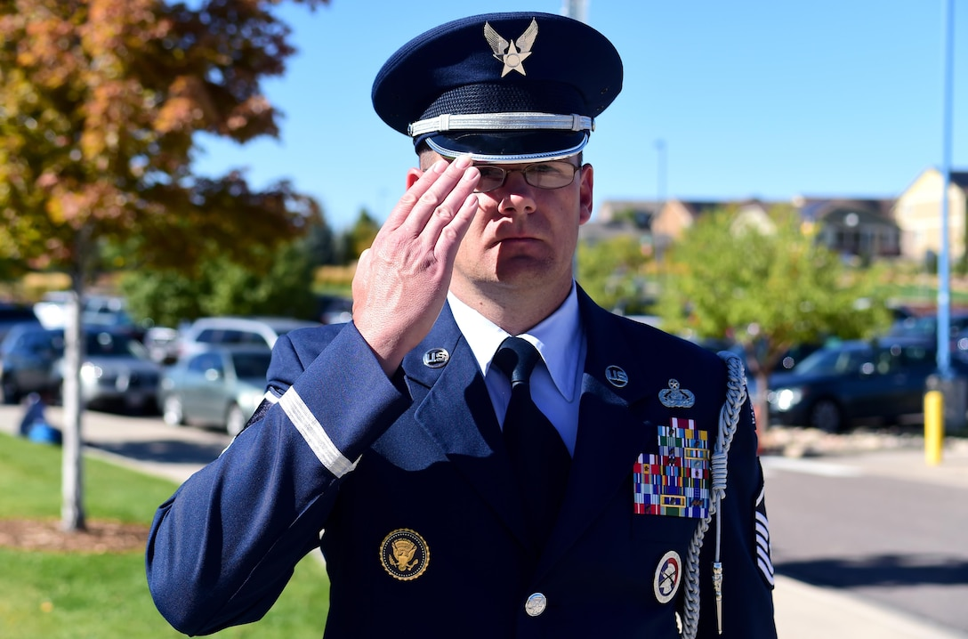 Master Sgt. Michael Rutherford, U.S. Air Force Mile High Honor Guard superintendent, renders a salute to the American flag Sep. 27, 2016, at Aurora Frontier P-8 in Aurora, Colo. While it is common for civilians to hold their right hand over their heart, rendering a salute has become a courtesy for men and women in the armed forces. (U.S. Air Force photo by Airman Holden S. Faul/ Released)