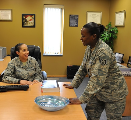 Area Defense Counsel Capt. M. Dedra Campbell and Defense Paralegal Staff Sgt. Natesha Champion represent the Area Defense Counsel on Grand Forks Air Force Base, N.D. Sept. 28. The ADC operates under a separate chain of command which allows the ADC to provide confidential legal advice without command influence. (U.S. Air Force photo by Airman 1st Class Elijaih Tiggs)