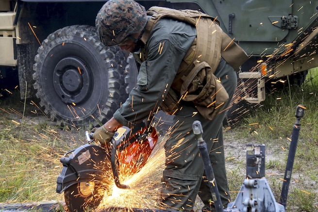 A Marine salvages an aircraft rotor during a field exercise at Camp Davis, N.C., Sept. 22, 2016. The exercise featured events such as auxiliary airfield construction, ground security and airfield damage repair. Marine Corps photo by Lance Cpl. Mackenzie Gibson