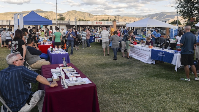 Members from various agencies and non-profit organizations talk to guests at the annual Zoo After Hours event at Alameda Park Zoo in Alamogordo, N.M. on Sept. 24, 2016. The event was open to all active duty military personnel and their families. (U.S. Air Force photo by Airman 1st Class Alexis P. Docherty)