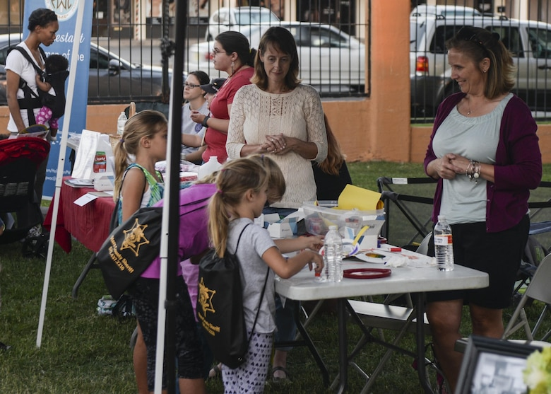 A group of young girls talk to women from a local organization at the annual Zoo After Hours event at Alameda Park Zoo in Alamogordo, N.M. on Sept. 24, 2016. The event featured various on- and off-base support agencies and non-profit organizations. (U.S. Air Force photo by Airman 1st Class Alexis P. Docherty)