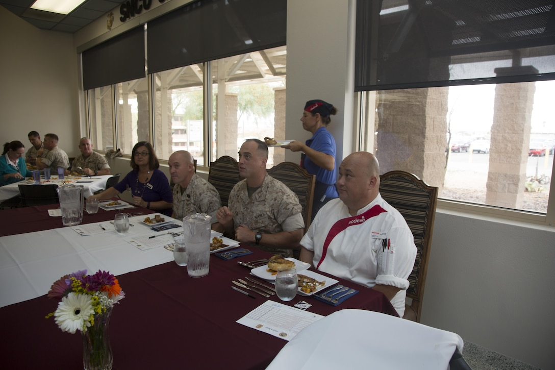 Judges critique a dish from one of three participating teams during the Chef of the Quarter competition at Phelps Mess Hall aboard Marine Corps Air Ground Combat Center, Twentynine Palms, Calif., Sept. 21, 2016. The competition is held every quarter and provides Marine and civilian chefs aboard the installation an opportunity to showcase their cooking expertise. (Official Marine Corps photo by Lance Cpl. Eric Clayton/Released)
