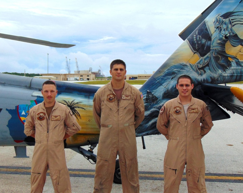 From left to right, Lt. Walter McGann, Naval Aircrewman First Class Johnathan Hampton, Naval Corpsman Third Class Jacob Tittle, (not pictured) AWS2 Ryan Duran-fujii and Lt. William B. Thornley, Helicopter Sea Combat Squadron Two-Five search and rescue crew members stand in front of a MH-60S Seahawk  at Andersen Air Force Base, Guam. The team recently won the 2015 Naval Helicopter Association Aircrew of the Year award for their heroic efforts during a search and rescue mission resulting in fives lives being saved. (Courtesy photo)