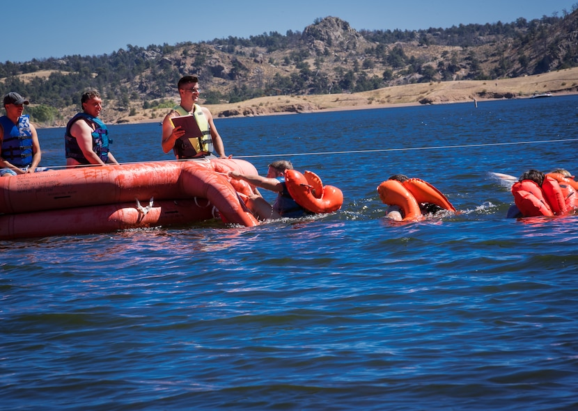 U.S. Air Force airmen assigned to the 153rd Airlift Wing, Wyoming Air National Guard board a 20-man life raft during water survival training Sept 10, 2016, at Curt Gowdy state park, Cheyenne, Wyoming. Aircrew flight equipment instructors recertify aircrew members water survival skills every three years.  (U.S. Air National Guard photo by Tech. Sgt. John Galvin)