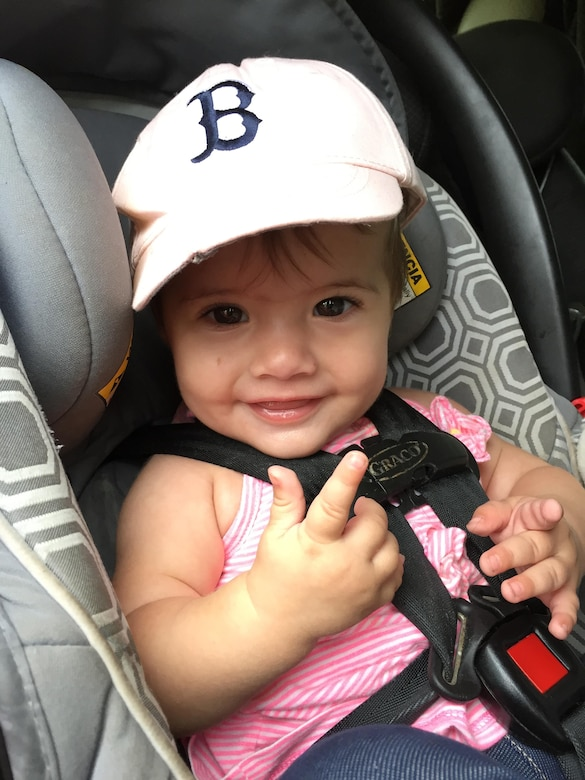 This nine-month-old sits happily andcomfortably rear-facing in her car seat. The American Association of Pediatrics recommends children remain rear-facing for a minimum of two years. (U.S. Air Force photo/ W.C. Pope)