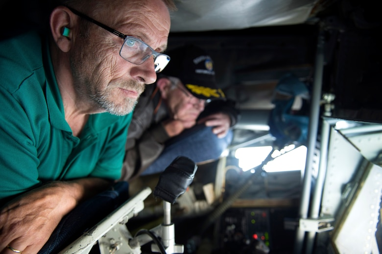 Ewald Heck, mayor of Landsheid, Germany, and Roger Feller, honorary commander of the 52nd Operations Group at Spangdahlem Air Base, Germany, stare out the boom window of a KC-135 Stratotanker from the 191st Air Refueling Squadron, Air National Guard Base, Utah, during a refueling mission over Ramstein Air Base, Sept. 26, 2016. The Stratotanker supplied 120,000 pounds of fuel to 13 of Spangdahlem's F-16 Fighting Falcons during the course of two days. (U.S. Air Force photo/Airman 1st Class Preston Cherry)