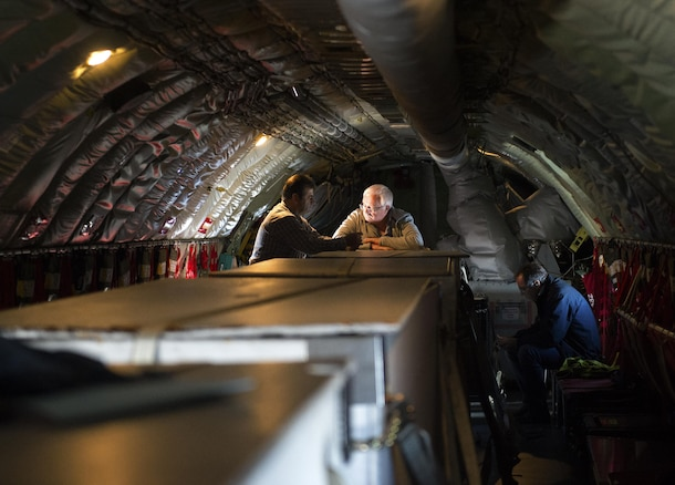 Saber civic leaders wait in a U.S. Air Force KC-135 Stratotanker from the 191st Air Refueling Squadron, Roland R. Wright Air National Guard Base, Utah, for an opportunity to see F-16 Fighting Falcons assigned to the 52nd Fighter Wing, Spangdahlem Air Base, Germany, during a refueling mission over Ramstein Air Base, Sept. 26, 2016. The Stratotanker carried and transferred more than 120,000 pounds of fuel to 13 F-16s during the course of two days. (U.S. Air Force photo/Airman 1st Class Preston Cherry)