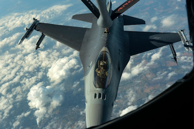 A U.S. Air Force KC-135 Stratotanker, assigned to the 191st Air Refueling Squadron from Roland R. Wright Air National Guard Base, Utah, refuels an F-16 Fighting Falcon assigned to the 52nd Fighter Wing, Spangdahlem Air Base, Germany, Sept. 27, 2016. The Utah ANG unit conducted the routine in-flight refueling to garner experience working with F-16s. (U.S. Air Force photo/Senior Airman Dawn M. Weber)