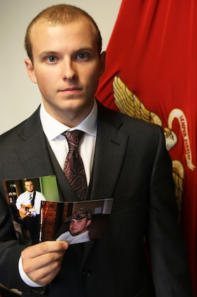 Connor Anteau holds up pictures of his dramatic weight loss transformation after giving his oath of service August 25, 2016 in Ann Arbor, Michigan. Antea is a Gibraltar, Michigan native who lost nearly 60 pounds to join the United States Marine Corps. (U.S. Marine Corps photo by Sgt. J. R. Heins/ Released)