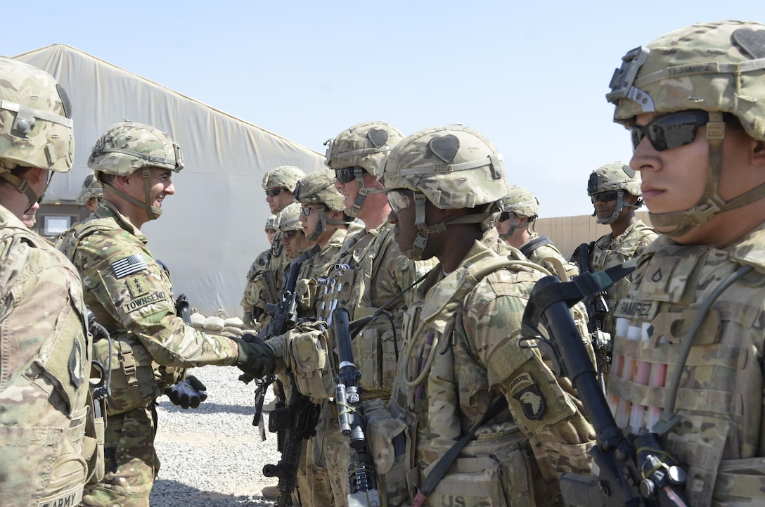 Lt. Gen. Stephen J. Townsend, commander Combined Joint Task Force Operation Inherent Resolve, awards a coin to Private First Class Nathaniel Hill, Utilities Equipment Repairer with Golf Company, 526th Brigade Support Battalion, Task Force Strike, 101st Airborne Division (Air Assault), stationed at Fort Campbell, Kentucky. Coalition troops arrived to Qayyarah West Airfield to enable the Iraqi Security Forces to defeat Da'esh by providing logistical, engineering and artillery fires in support of the liberation of Mosul. The mission of Operation Inherent Resolve is to defeat Da'esh (an Arabic acronym for ISIL) in Iraq and Syria by supporting the Government of Iraq with trainers, advisors and fire support, to include aerial strikes and artillery fire. (USMC photo by Capt. Ryan E. Alvis/Released)