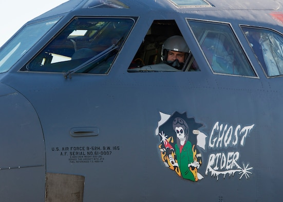 Lt. Col. Jeremy Holmes, 69th Bomb Squadron commander, peers out a window of the B-52H Stratofortress Ghost Rider at Minot Air Force Base, N.D., Sept. 27, 2016. In 2008, Ghost Rider was sent to the 309th Aerospace Maintenance and Regeneration Group, aka Boneyard, at Davis-Monthan AFB, Ariz., and has spent the last year at both Barksdale AFB, La. and Tinker AFB, Okla., undergoing equipment transfers of usable equipment and undergoing inspections and corrective maintenance actions to ensure its airworthiness. (U.S. Air Force photo/Airman 1st Class J.T. Armstrong)