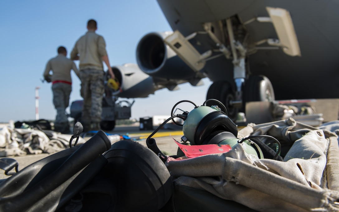 Personal protective equipment lays on the flightline before Airmen from the 721st Aircraft Maintenance Squadron service liquid oxygen for a C-17 Globemaster III Sept. 22, 2016 at Ramstein Air Base, Germany. Liquid oxygen can cause severe burns, so while the Airmen pump it into the aircraft, they are required to wear protective gear.